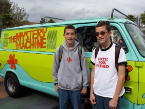 Joshua (left) and Jacob in front of the Scooby Doo Mystery Machine at Universal Studios.