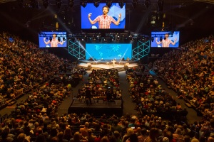 Over 5000 Cru Staff from all over the U.S. inside Moby Gym for a main meeting session of Cru15.