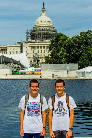 Joshua (left) and Jacob pose in front of the U.S. Capitol building.